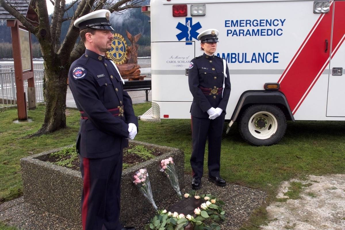BC Ambulance Service honour guards Lonnie Barkhouse of Chilliwack, left, and Rosalene Berg of Abbotsford stand guard at Schlamp's memorial plaque. Barry Stewart photo